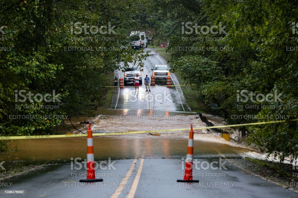 Police block a road in Union County, NC that is flooded by Hurricane Florence stock photo