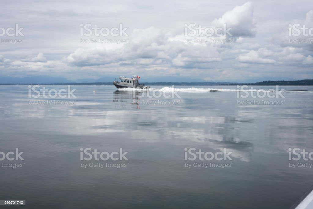 Police boat monitoring fishing activity stock photo
