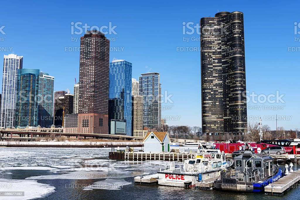 Police boats and skyscrapers, mouth of frozen Chicago River stock photo