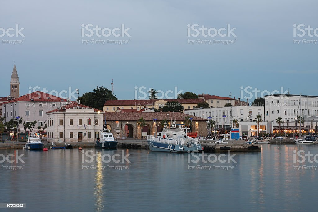 Police  boats moored in harbor in Koper after sunset time stock photo