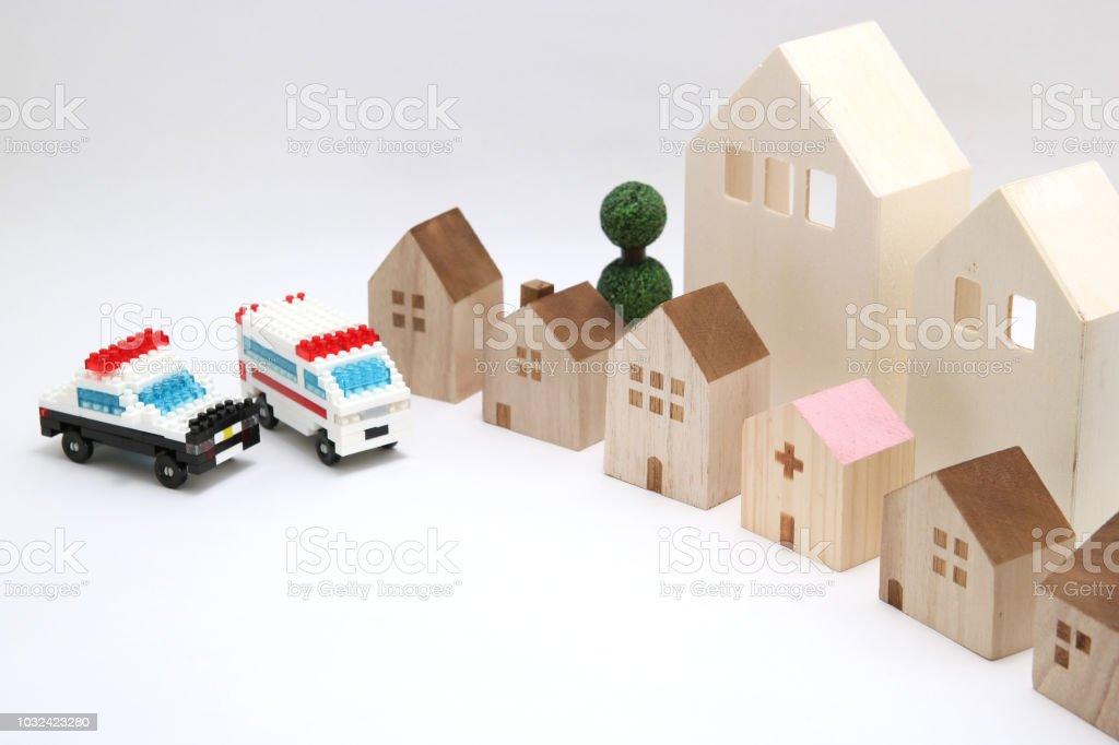 Police car and ambulance heading to hospital on white background. stock photo