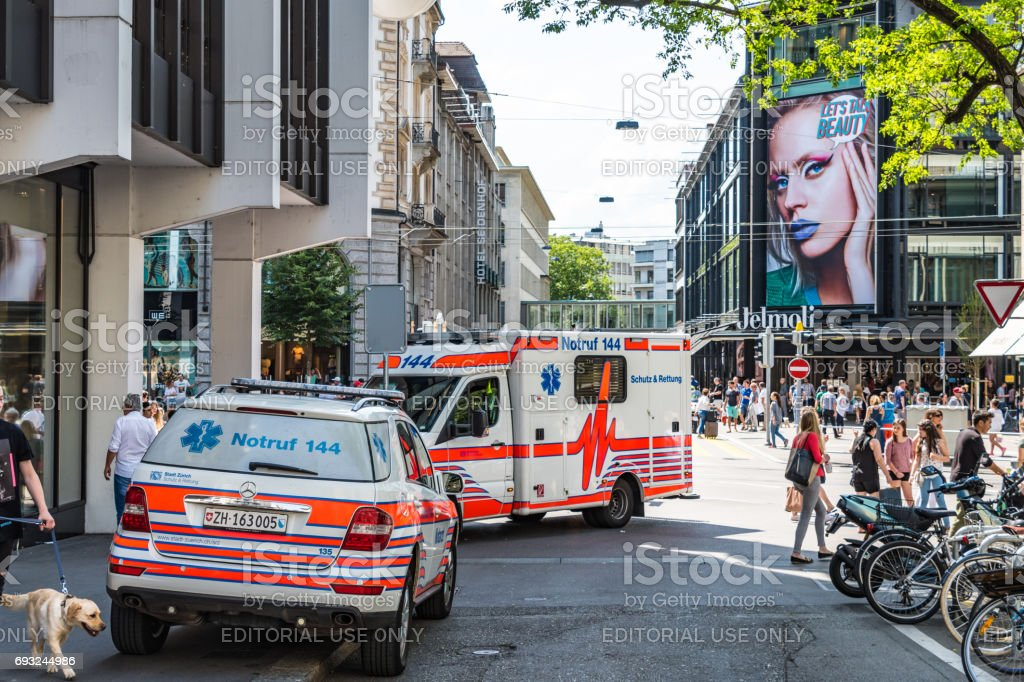 Police car and ambulance in Zurich city centre stock photo