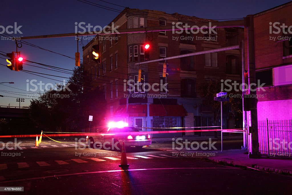 Police car and crime scene tape on a city street stock photo