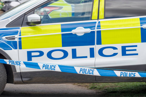 Police Car and Tape Cordon stock photo