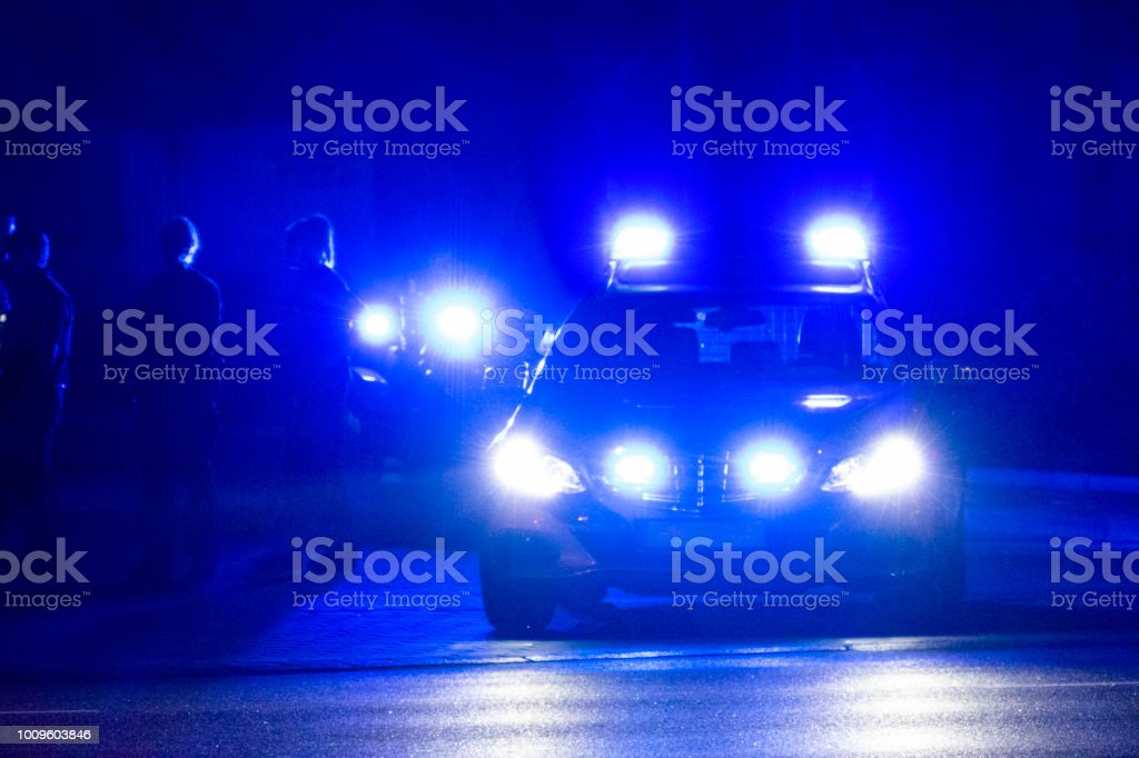 Police car at night stock photo