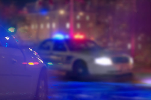 istock US police car at night. 1076201556