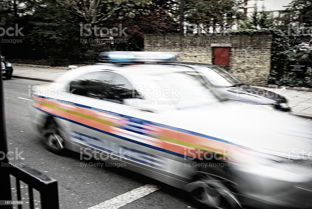 Police car chase, blurred motion in city street stock photo