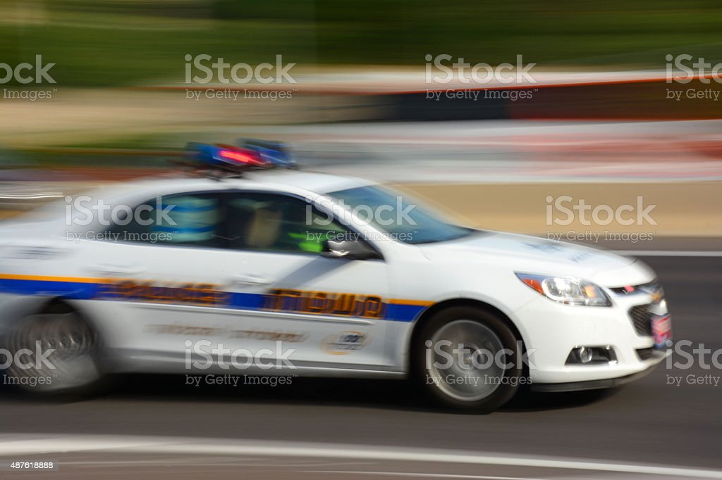 Police car in motion stock photo