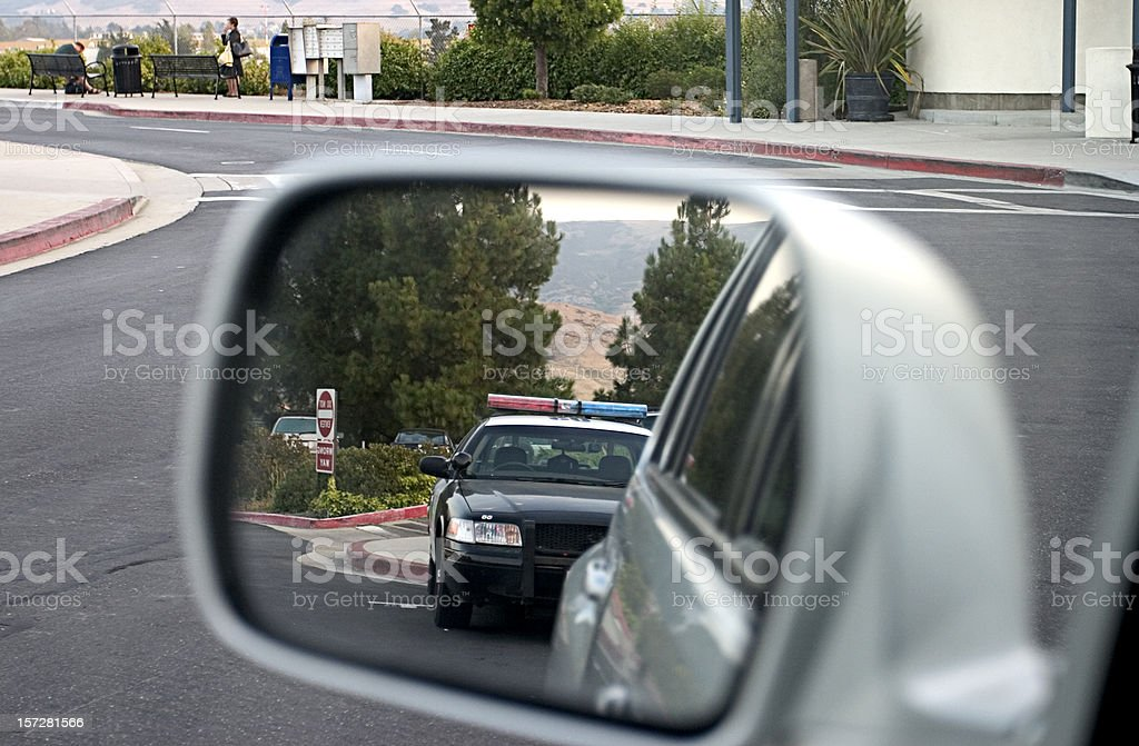 Police car in rear view mirror royalty-free stock photo
