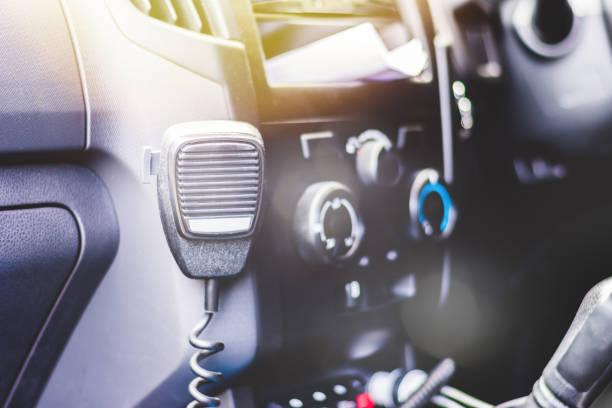 police car interior with cb radio - talk in a radio foto e immagini stock
