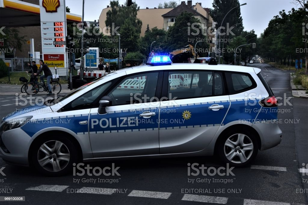 Berlin, Germany police car is standing on the signal