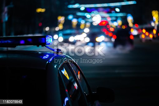 police car lights at night in city with selective focus and boke blur.