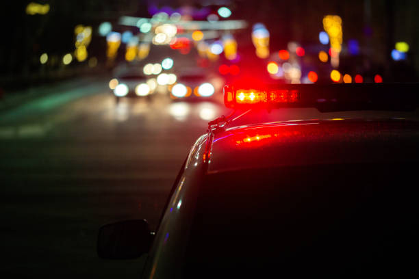 police car lights at night in city with selective focus and bokeh stock photo