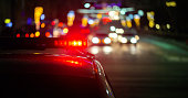 istock police car lights in night city with selective focus and bokeh 1226804280