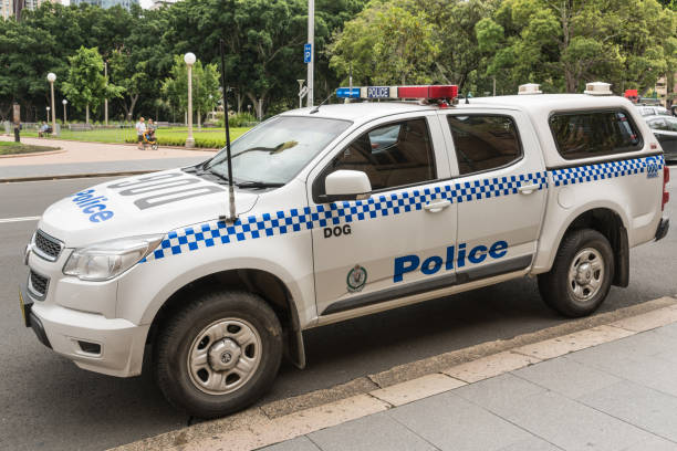 Police car parked on College Street, Sydney Australia. stock photo