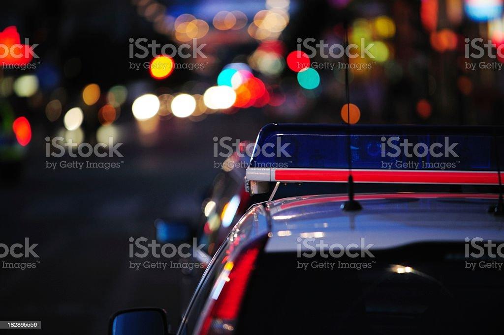 Police car reflecting night lights stock photo