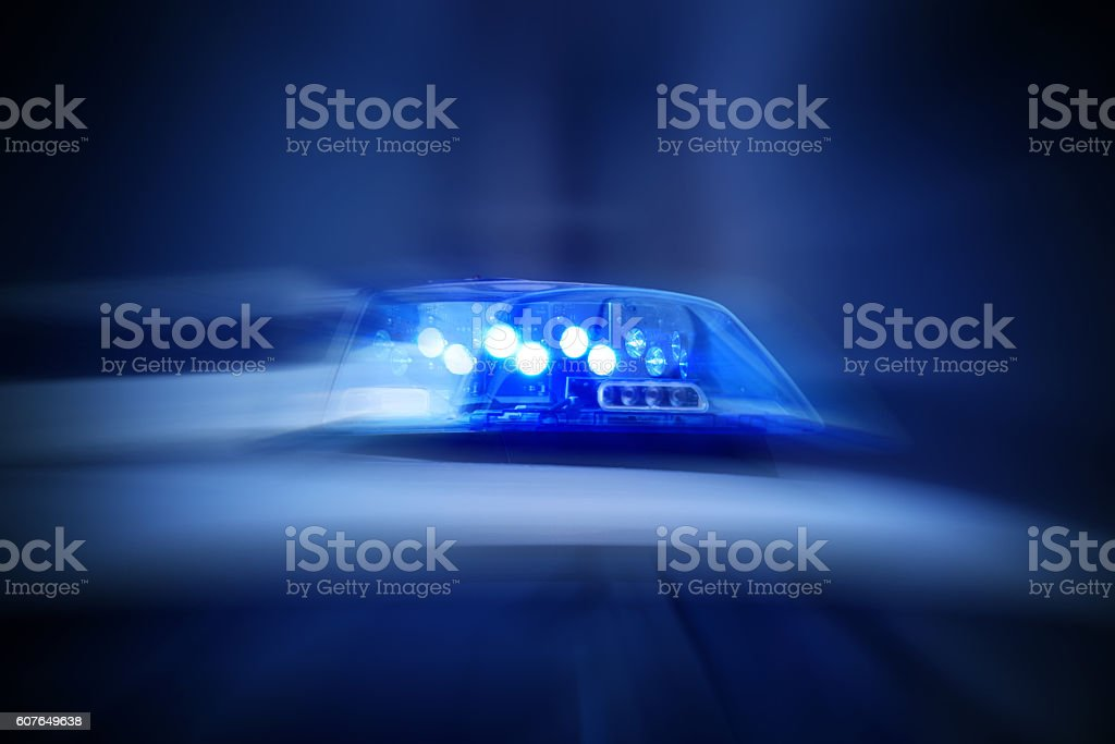 police car with blue lights switched on – Foto