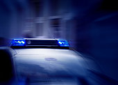 police car with switched on emergency lights