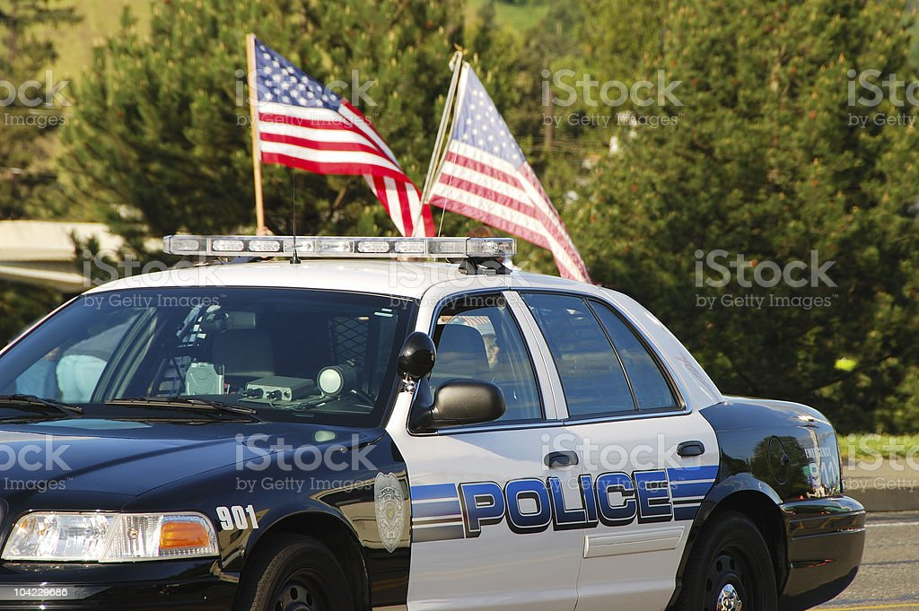 Police car with two American flags on top stock photo