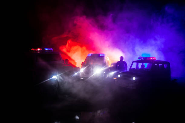 Police cars at night. Police car chasing a car at night with fog background. 911 Emergency response pSelective focus – zdjęcie