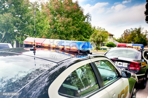 HDR shot of two police cars