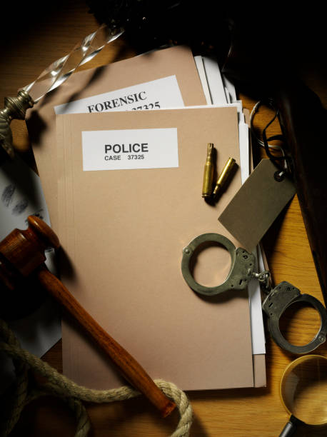 police case file with surrounding evidence - murder mystery stock photos and pictures