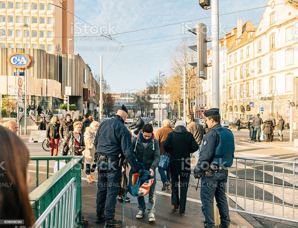 Police check-point verifying all pedestrian before entering city stock photo