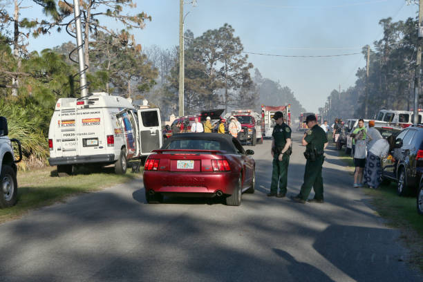 Police Control Traffic at Forest Fire Press Briefing stock photo
