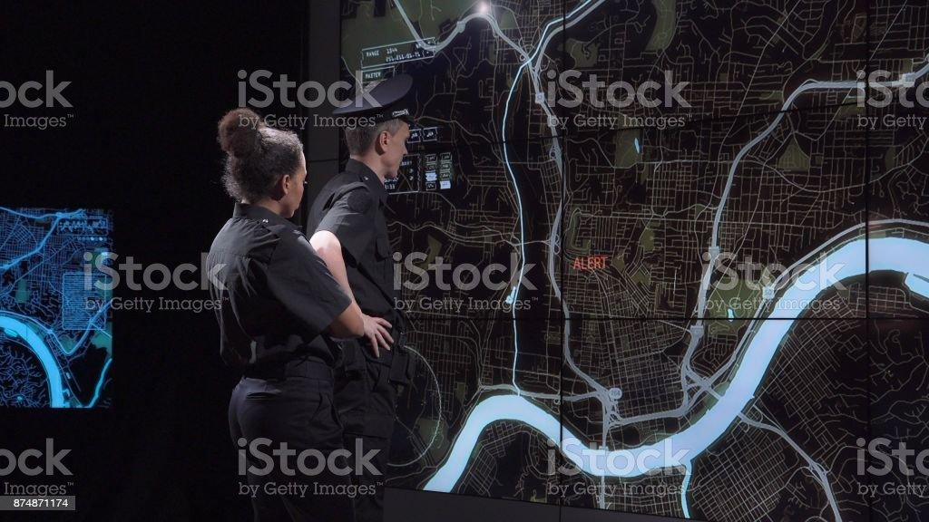 Police coordination team in modern office stock photo