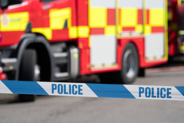 Police Cordon Tape and Fire Engine stock photo