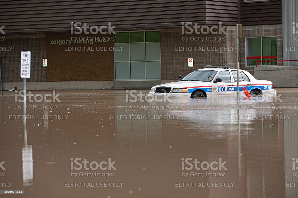 Police Cruiser Underwater in the Flooded Streets of Calgary; royalty-free stock photo