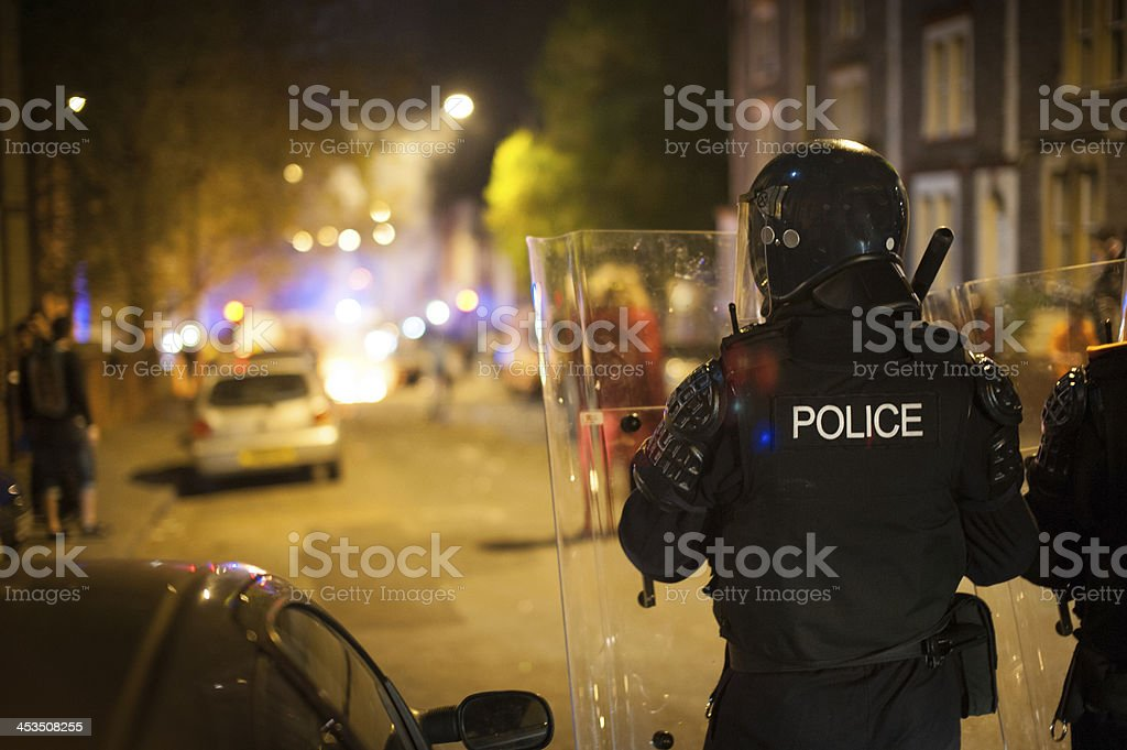Police defending riot stock photo