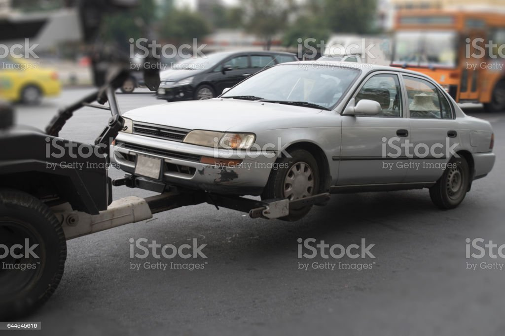 police department tow truck delivers the damaged vehicle stock photo