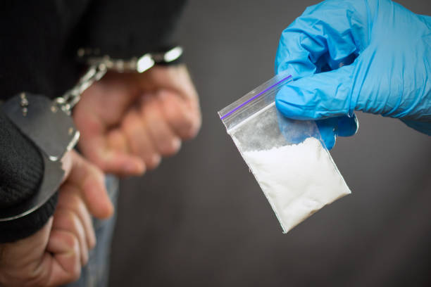 police detention drug courier. A police officer finds drugs during the search of drug dealers crime stock pictures, royalty-free photos & images