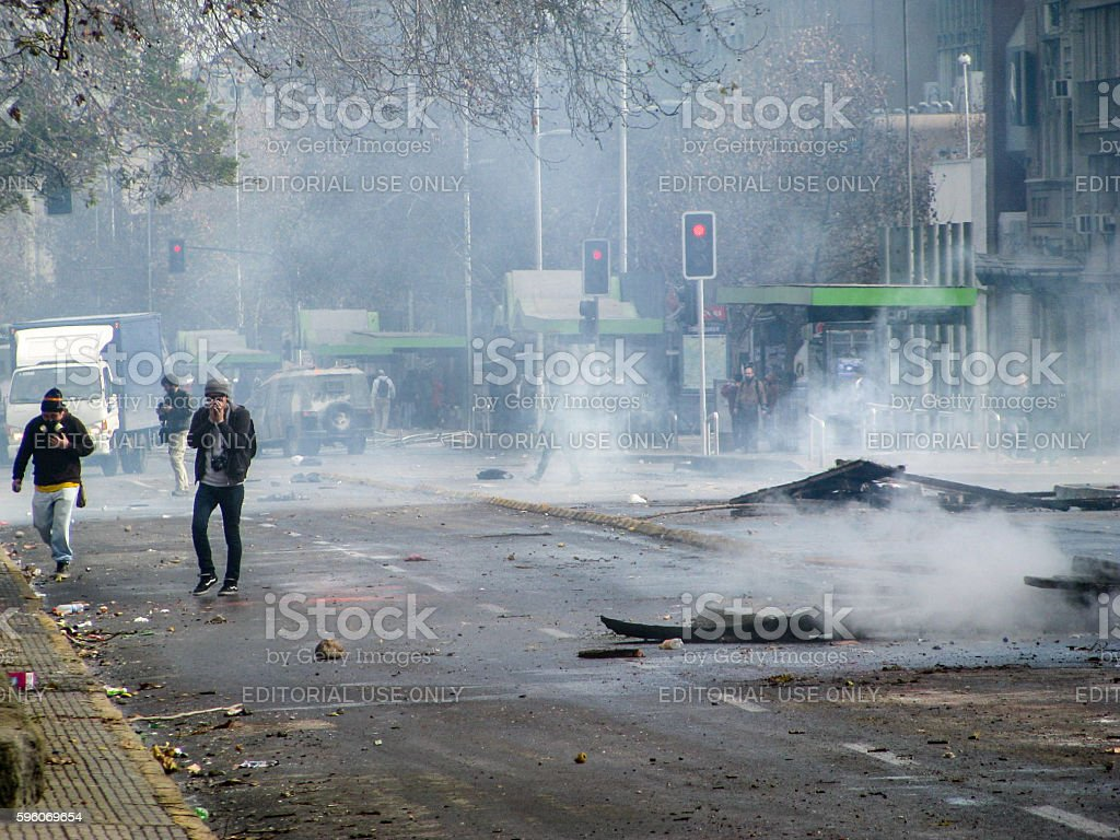 Police disperse activists with tear gas royalty-free stock photo