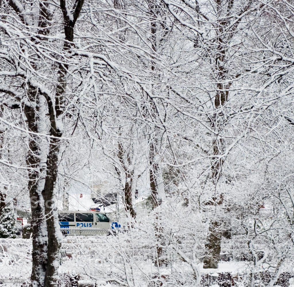 Police Driving Through Snow Covered Park royalty-free stock photo
