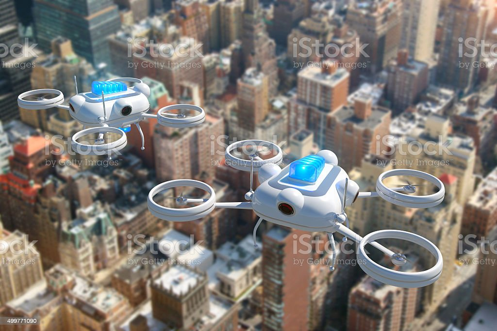 Police drones with blue emergency lights flying over New York stock photo