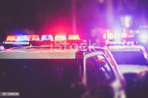 Police DUI Nigh Time Checkpoint. Police Cruiser Lights Closeup Photo.