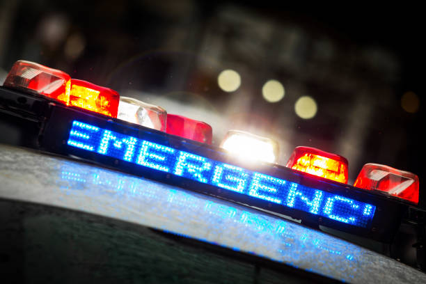Police emergency lights with warning text stock photo