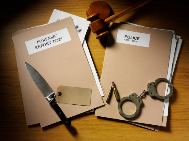 police files with handcuffs, knife and bullets - murder mystery stock photos and pictures