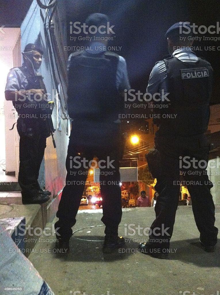 Police guarding favela streets. royalty-free stock photo