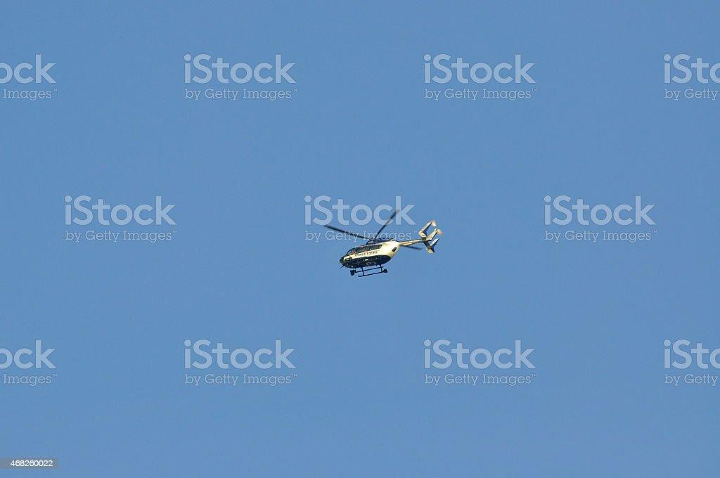 FRANKFURT, GERMANY - MARCH 18, 2015: Police helicopter, Demonstr stock photo