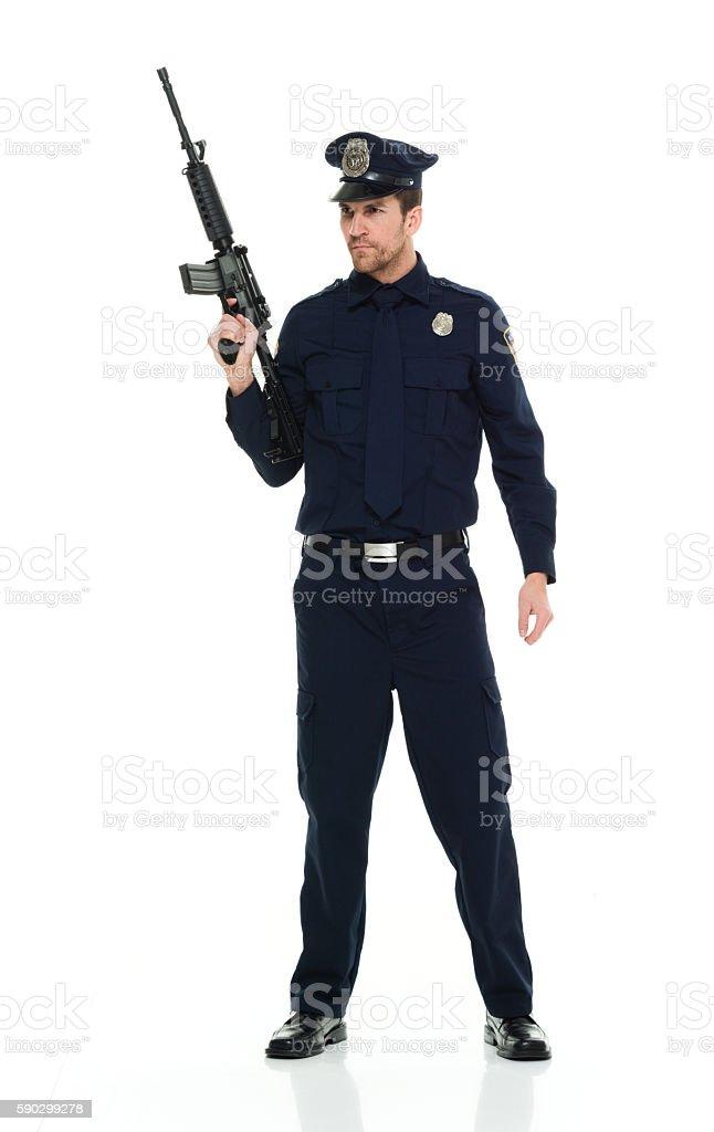 Police holding rifle royaltyfri bildbanksbilder