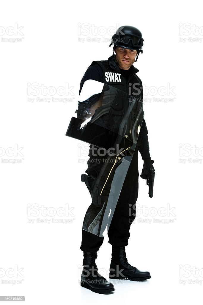 Police holding riot shield stock photo