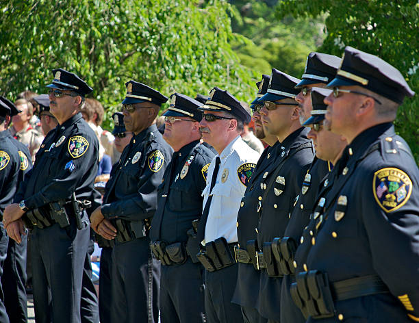 Police in formation at Memorial Day ceremony,Connecticut, USA stock photo