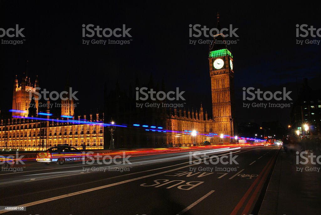 Police in London at Big Ben and Westminster Abbey night stock photo