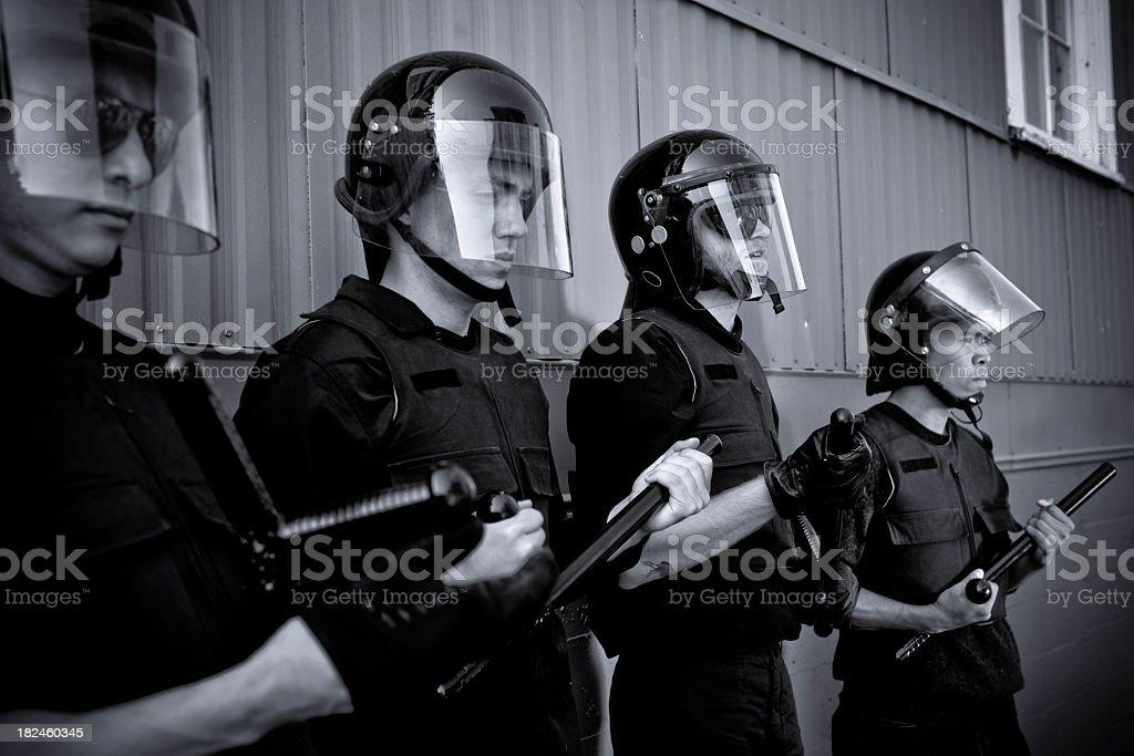 Police in riot gear royalty-free stock photo