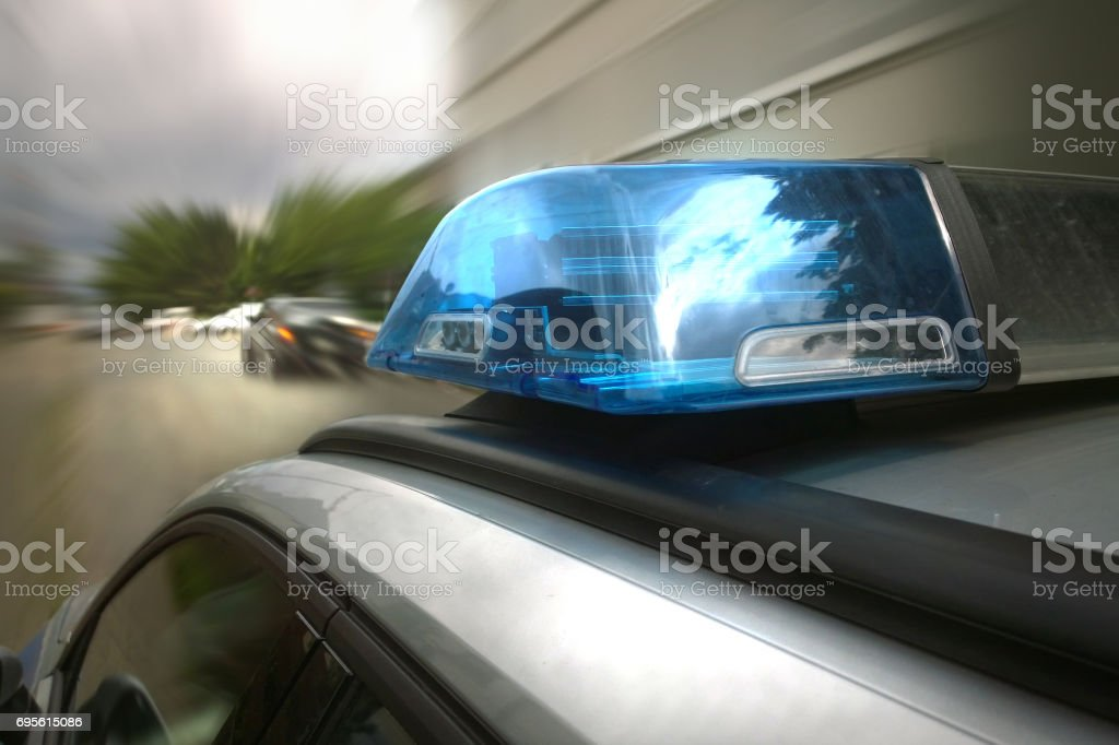 Police is following a car stock photo