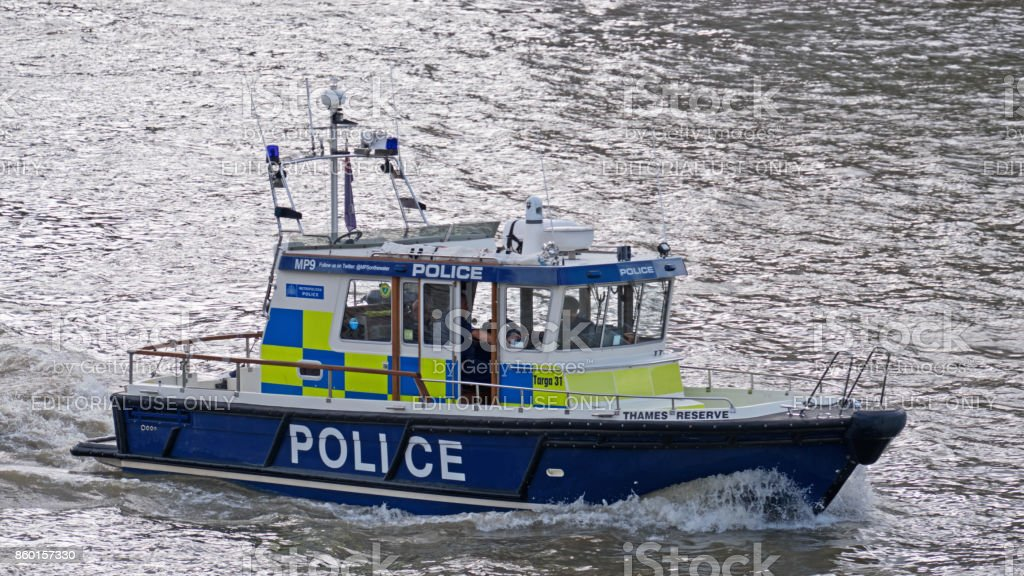 Police launch on the river Thames stock photo