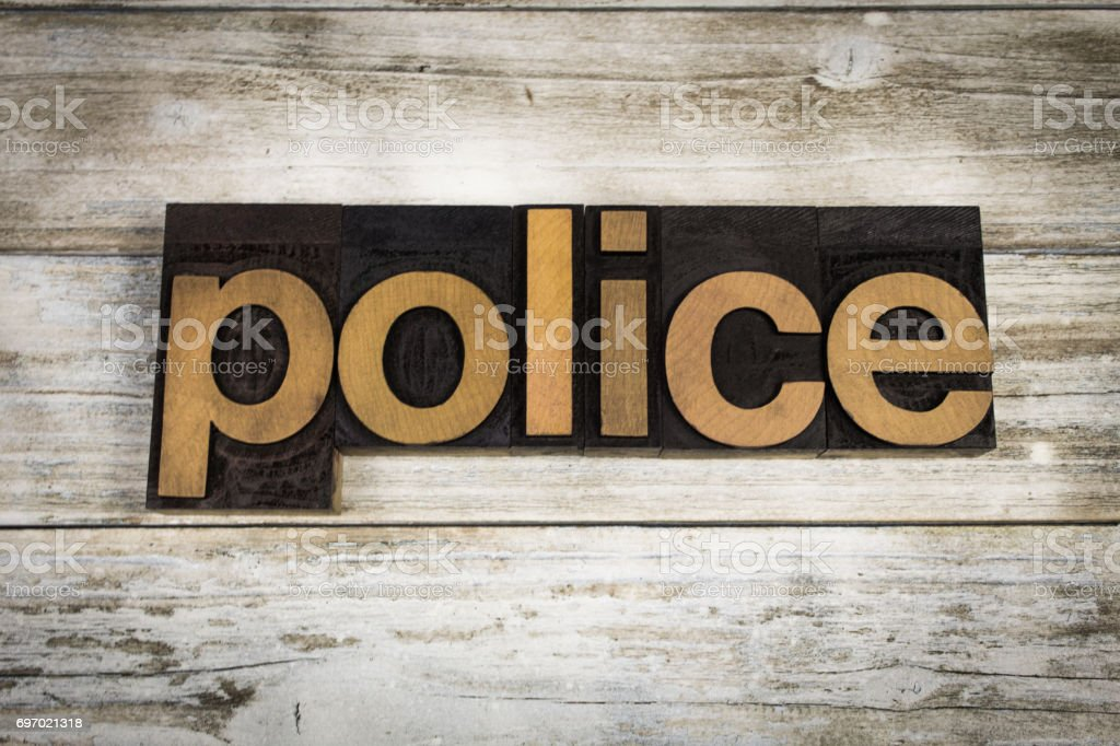 Police Letterpress Word on Wooden Background stock photo